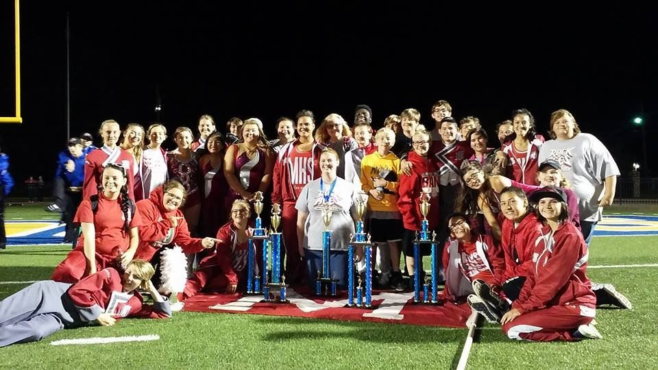 Picture of band with trophies at Piedmont